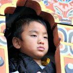 Kid looking via Window